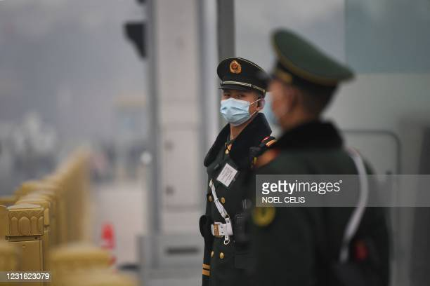 Paramilitary police stand guard at Tiananmen Square ahead of the closing session of the Chinese People's Political Consultative Conference in Beijing...