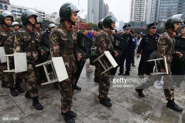 Paramilitary police wait to get into position outside the Helong stadium before the World Cup football qualifying match between China and South Korea...
