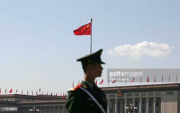 Paramilitary policeman guards in front of the Great Hall of the People, where the 17th National Congress of the Communist Party of China is held 2on...