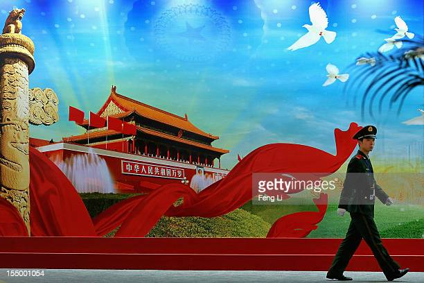 """Paramilitary policeman patrols during an exhibition entitled """"Scientific Development and Splendid Achievements"""" before the18th National Congress of..."""