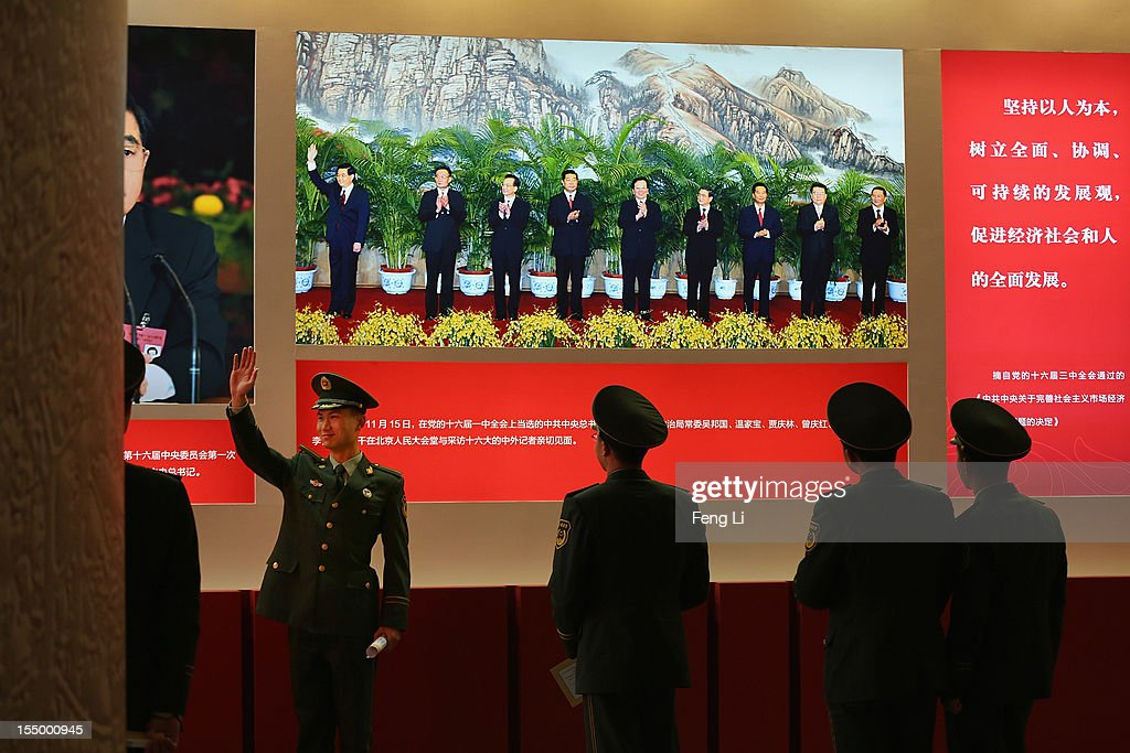 A paramilitary policeman poses for photo in front of the photo of China's President Hu Jintao as visiting an exhibition entitled 'Scientific Development and Splendid Achievements' before the18th National Congress of the Communist Party of China (CPC) on October 30, 2012 in Beijing, China. The exhibition showcases China's progress in political, economic, cultural and ecological spheres over the past decade. The18th National Congress of the Communist Party of China (CPC) is proposed to convene on November 8 in Beijing.