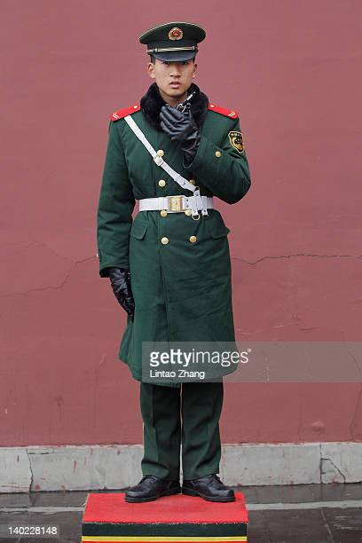 A paramilitary policeman stands guard at the entrance of the Forbidden City on March 1 2012 in Beijing China The Chinese People's Political...
