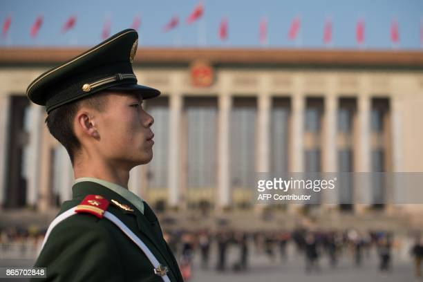 A paramilitary policeman stands guard at Tiananmen square during the closing session of the 19th Communist Party Congress in Beijing on October 24...