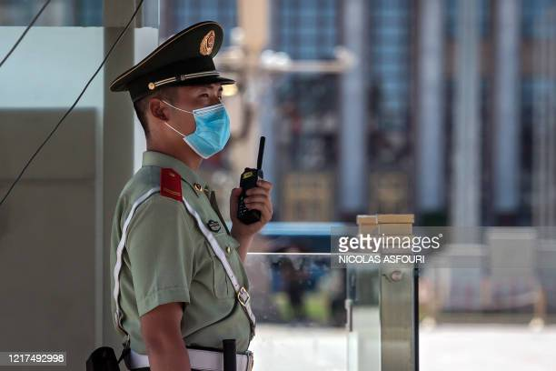 A paramilitary policeman stands guard on Tiananmen Square in Beijing on June 4 2020 This year marks 31 years since the Tiananmen crackdown on June 4...