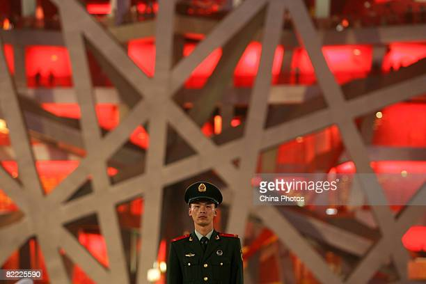 A paramilitary policeman stands guard outside the National Stadium during the Opening Ceremony for the Beijing 2008 Olympic Games on August 8 2008 in...