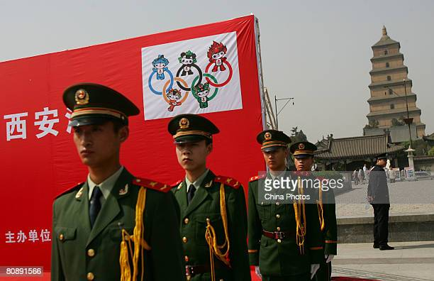 Paramilitary policemen attend a ceremony to kick off an activity to promote fire prevention and mark the upcoming 100-day-countdown to the Beijing...
