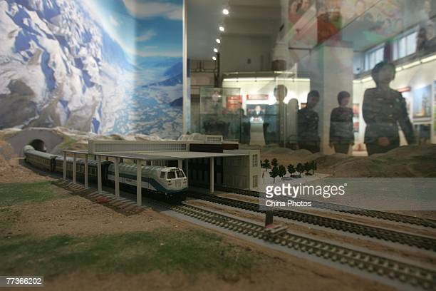 Paramilitary policewomen view the model of the QinghaiTibet Railway during 'Road Of Revival' Exhibition about the rejuvenation of China at the...