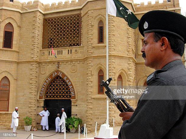 A paramilitary solder stand guard at the jail where the trial of three Islamic militants accused in the US consulate bombing case is being held...