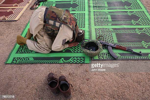 A paramilitary soldier from Pakistan's Frontier Corps prays November 20 2007 at Fizagat in the troubled Swat Valley of northwestern Pakistan The...