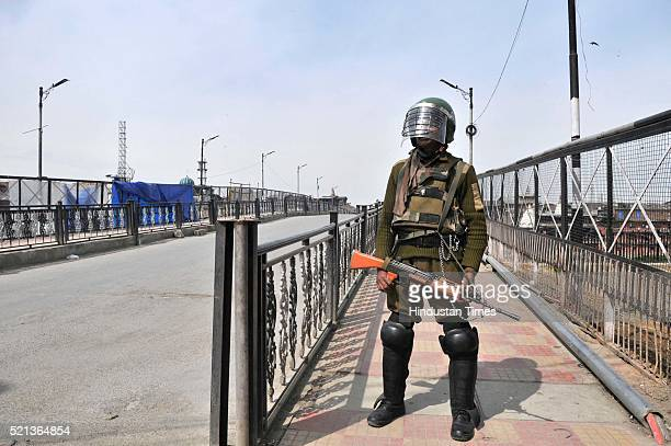 Paramilitary soldier stands guard during a restrictions in Lal chowk area of Srinagar on April 15 2016 in Srinagar India Authorities imposed severe...