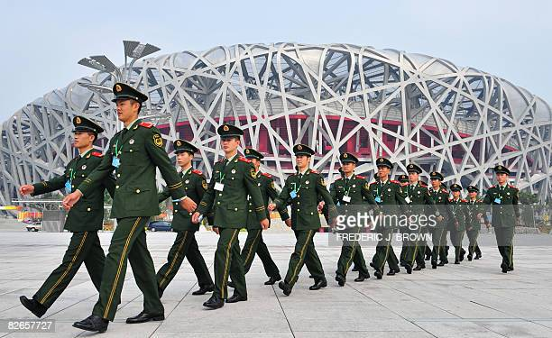 Paramilitary soldiers march past the National Stadium also known as the Bird's Nest during routine security drills on September 4 2008 ahead of the...