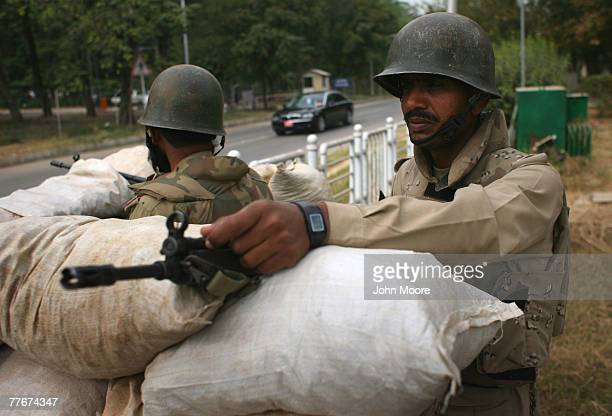 Paramilitary soldiers stand behind sandbags on November 4 2007 in Islamabad Pakistan On Saturday the government suspended Pakistan's constitution...