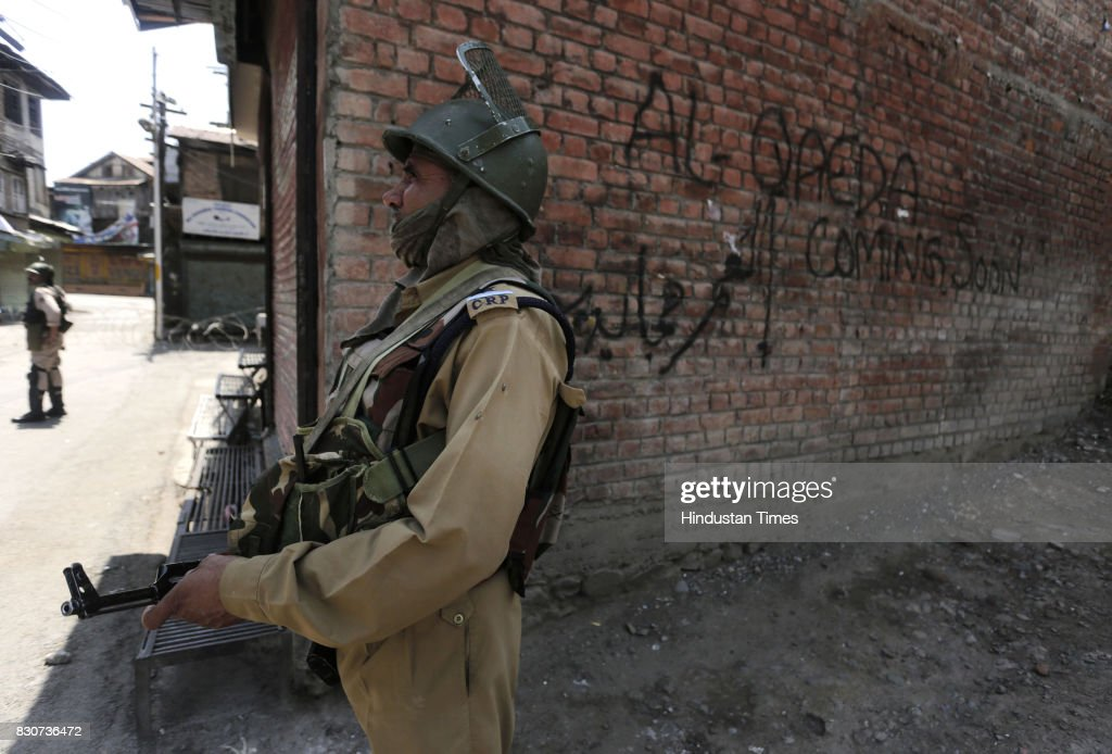 Paramilitary soldiers stand guard during restrictions in a downtown area on August 11, 2017 in Srinagar, India. Authorities imposed restrictions in parts of downtown Srinagar as separatists called a shutdown in Kashmir against a petition in the Supreme Court of India seeking abrogation of Article 35-A, which confers special rights on Jammu and Kashmir's permanent residents. The petition was filed in 2014 by a Non-Government Organisation (NGO) 'We The Citizens' seeking that the article be struck down. The petition alleges that the state government, under the guise of the article, discriminates against non-residents in matters of government jobs or buying property, according to news reports.