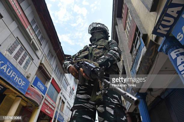 Paramilitary soldiers stand guard during restrictions on the first anniversary of the abrogation of Article 370 and Jammu and Kashmir's special...