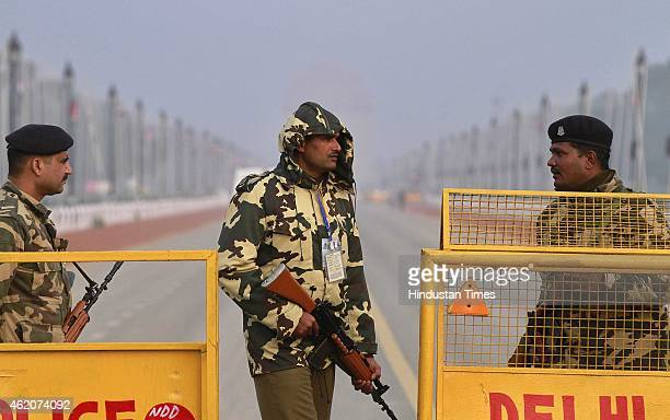 Paramilitary soldiers stand guard near Rajpath the ceremonial boulevard for Republic Day parade leading to the war memorial India Gate on January 24...