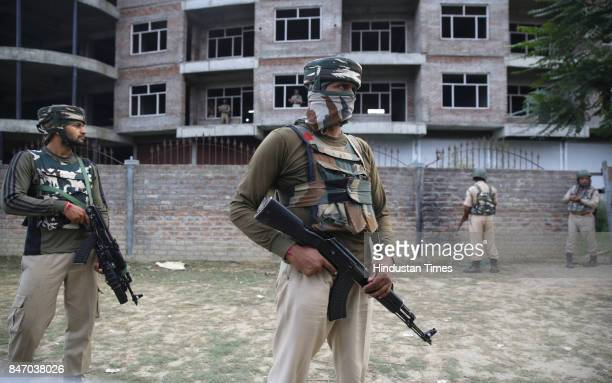 Paramilitary soldiers stand guard near the site of a gunfight between militants and forces at Nowgam on September 14 2017 on the outskirts of...