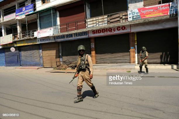 A police man stands guard on June 21 2018 in Srinagar India Separatists called for a shutdown in response to the killing of senior journalist Shujaat...