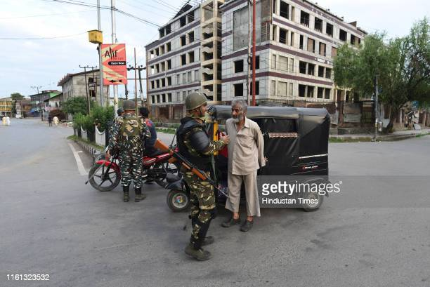 Paramilitary soldiers stop people during curfew on Eid al-Adha, at Down Town area on August 12, 2019 in Srinagar, India. The festive buzz was missing...