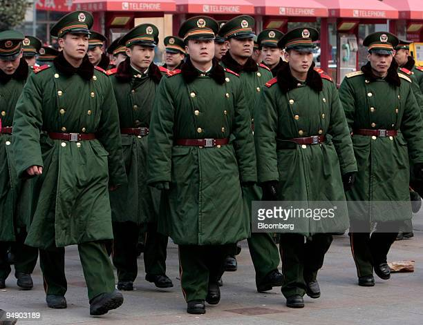 Paramilitary soldiers walk in front of the Shanghai Train Station in Shanghai China on Thursday Jan 31 2008 China is battling to prevent the worst...