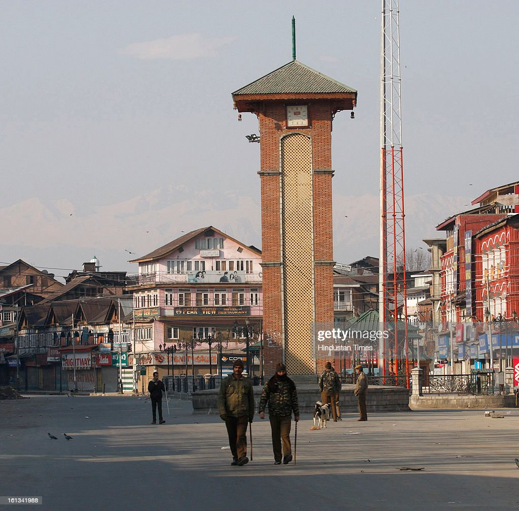 Paramilitary troop stand guard on deserted street after the parliament attack convict, Muhammad Afzal Guru was hanged in New Delhi, during Second day curfew on February 10, 2013 in Srinagar, India. Guru, who was found guilty of conspiring and sheltering the militants who attacked Parliament on December 13, 2001 in which nine people were killed, was buried in the prison premises as per the jail manual.