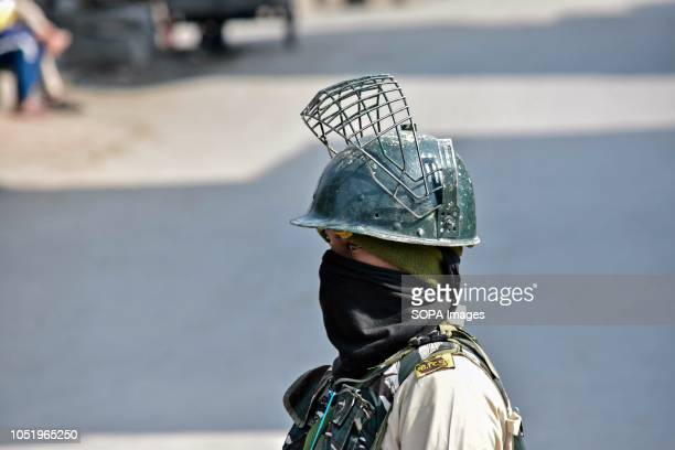 A paramilitary trooper keeps vigil during restrictions in Srinagar Indian administered Kashmir Authorities impose restrictions in Srinagar amid a...