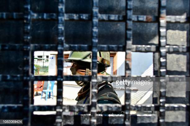 A paramilitary trooper keeps vigil inside the polling station during the third phase of local elections in Srinagar Indian administered Kashmir The...