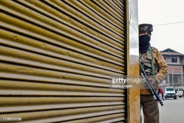 A paramilitary trooper seen standing alert during the shutdown in Maisuma locality of Srinagar Kashmir A spontaneous shutdown is being observed in...