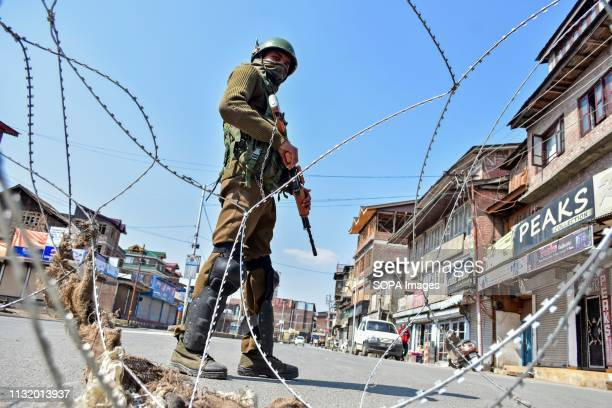 A paramilitary trooper seen standing guard during the restrictions in Srinagar Kashmir Authorities imposed restrictions in Old City of Srinagar...