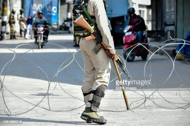 A paramilitary trooper stands alert during restrictions in Srinagar Indian administered Kashmir Authorities impose restrictions in Srinagar amid a...
