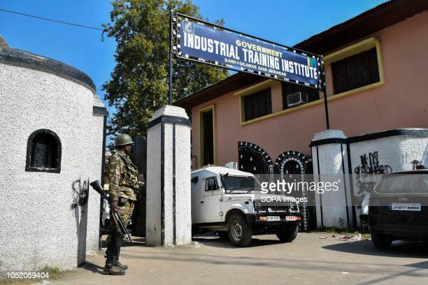 A paramilitary trooper stands alert outside the polling station during the third phase of local elections in Srinagar Indian administered Kashmir The...
