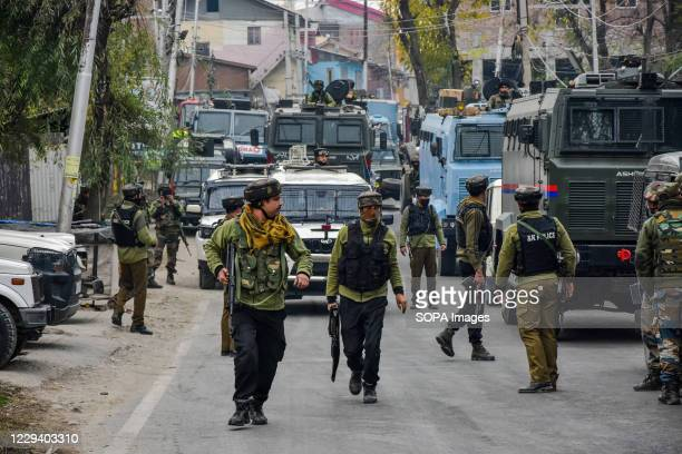Paramilitary troopers patrol near the encounter site on the outskirts of Srinagar. A top militant chief Saifullah Mir was killed in an encounter in...