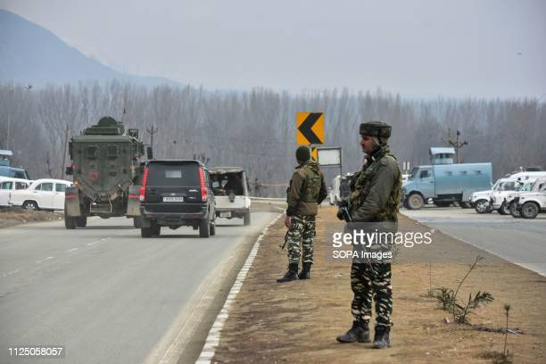 Paramilitary troopers seen keeping vigil as police vehicles patrol after the blast in Lethpora about 28kms from Srinagar Indian administered Kashmir...