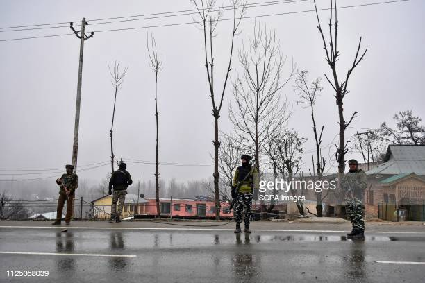 Paramilitary troopers seen keeping vigil close to the site of blast in Lethpora about 28kms from Srinagar Indian administered Kashmir At least 49...