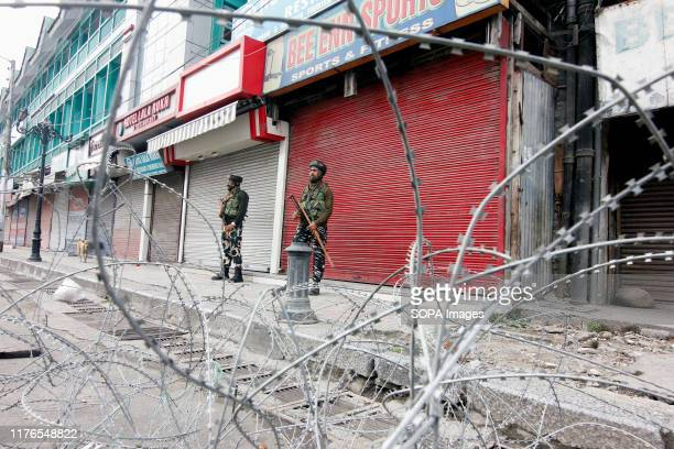 Paramilitary troopers stand on guard during the shutdown in Srinagar. Kashmir valley continued to remain shut on the 75th consecutive day against the...