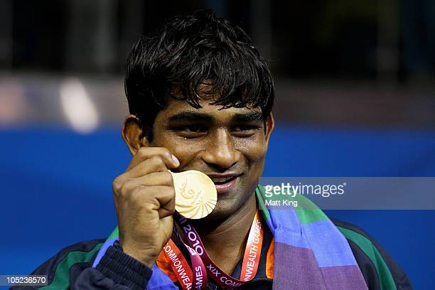 Paramjeet Samota of India poses with the gold medal during the medal ceremony for the Super Heavy Weight Men Finals Gold Medal Bout at Talkatora...