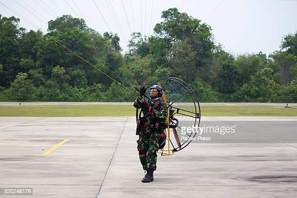 Paramotor pilots of Indonesian Air Force did a show at the Air Base Roesmin Nurjadin Pekanbaru on 70th anniversary of the Indonesian Air Force...