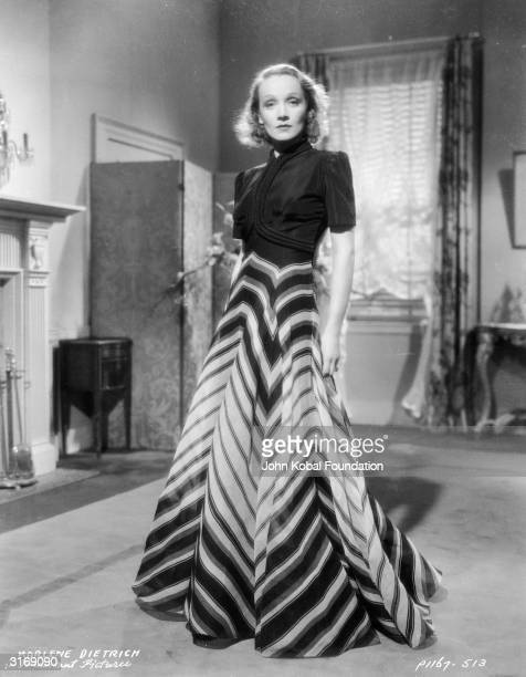 Paramount film star Marlene Dietrich in a tailored dress with a long skirt in a geometric pattern