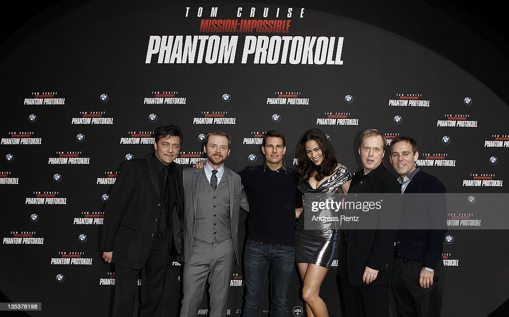 Paramount Germany CEO Sven Sturm, actors Simon Pegg, Tom Cruise, Paula Patton, director Brad Bird and producer Bryan Burk attend the 'Mission:Impossible - Ghost Protocol' Germany Premiere at BMW Welt on December 9, 2011 in Munich, Germany.