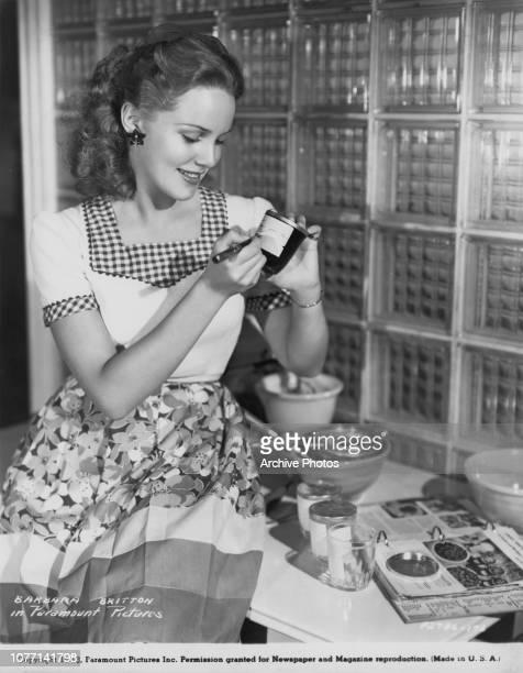 Paramount Pictures actress Barbara Britton prepares jars of jam 1943