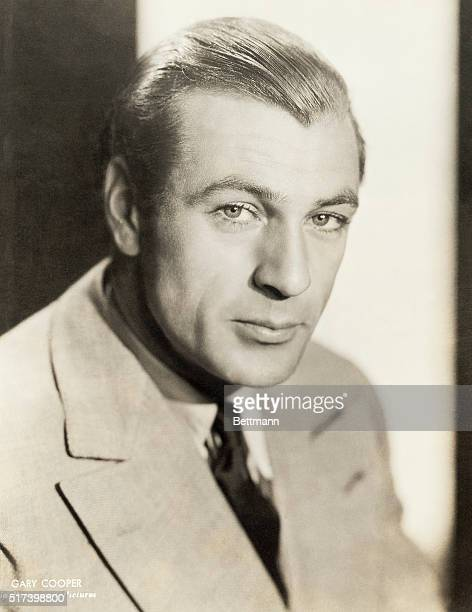 Paramount Pictures publicity portrait of actor Gary Cooper. He is shown in a head-and-shoulders view, wearing a suit and tie. Photograph, circa 1940.