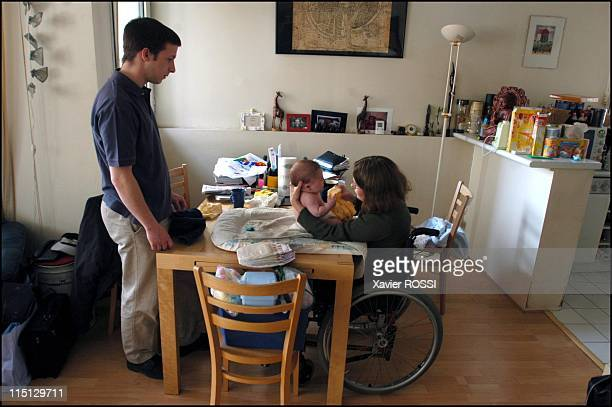 Paraplegic 25yearold Stephanie becomes mother in Paris France in February 2003 Under the caring glance of Georges Stephanie takes care of Come