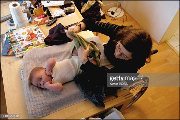 Paraplegic 25-year-old Stephanie becomes mother in Paris, France in February, 2003 - To each problem its solution. Only the lounge table has the...