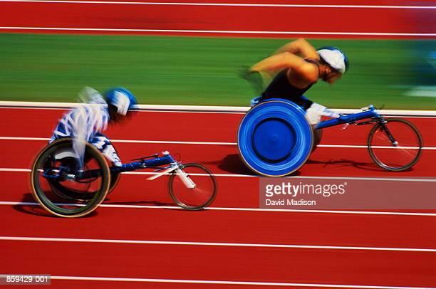 paraplegic athletes in action (blurred motion) - 障害者スポーツ ストックフォトと画像