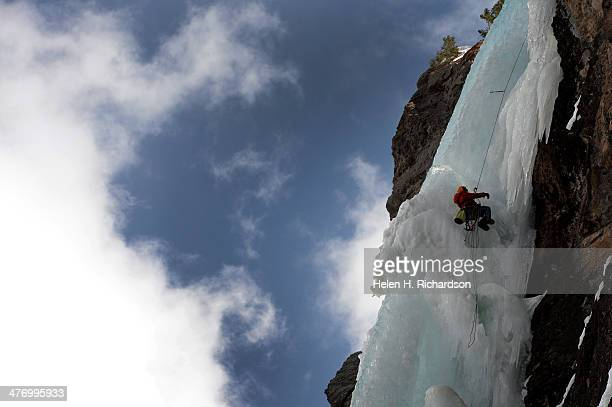 Paraplegic climber Sean O'Neill climbs the second pitch of Bridal Veil Falls ice climb by use of his arms pulleys and ice picks as he and climbing...