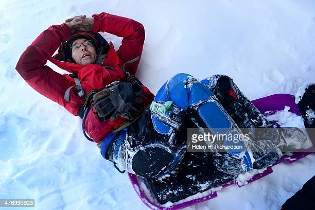 Paraplegic climber Sean O'Neill looks up at the ice climb Bridal Veil Falls before climbing it with climbing guide Andres Marin in Telluride Co on...