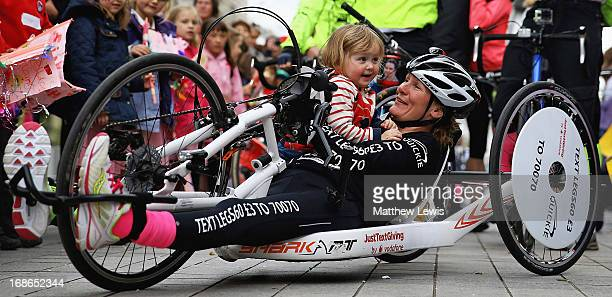 Paraplegic fundraiser Claire Lomas pictured with her daughter Maisie after finishing her 400 mile hand bike challenge at the London Eye She has...