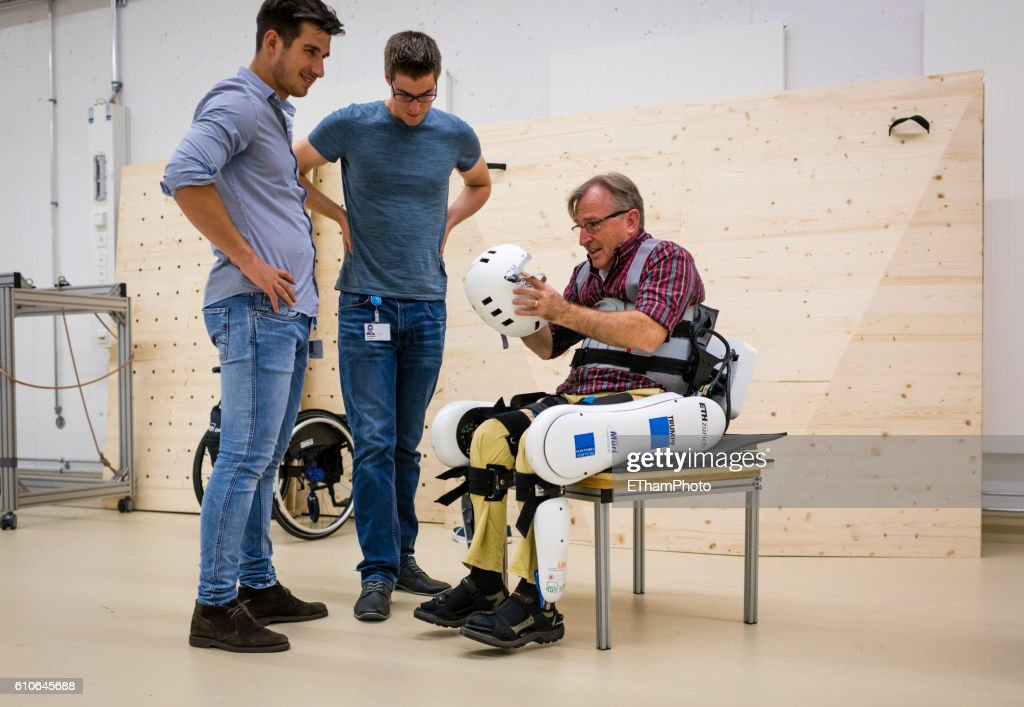 Paraplegic learns to walk again with electrically powered exoskeleton at research lab of ETH Zurich : Stock Photo