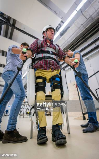 paraplegic learns to walk again with electrically powered exoskeleton at research lab of eth zurich - paraplegic zurich stock pictures, royalty-free photos & images