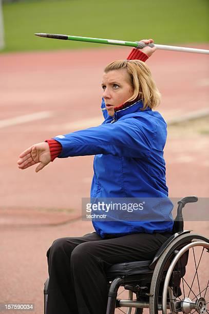 paraplegic on wheelchair exercising javelin - paraplegic stock photos and pictures