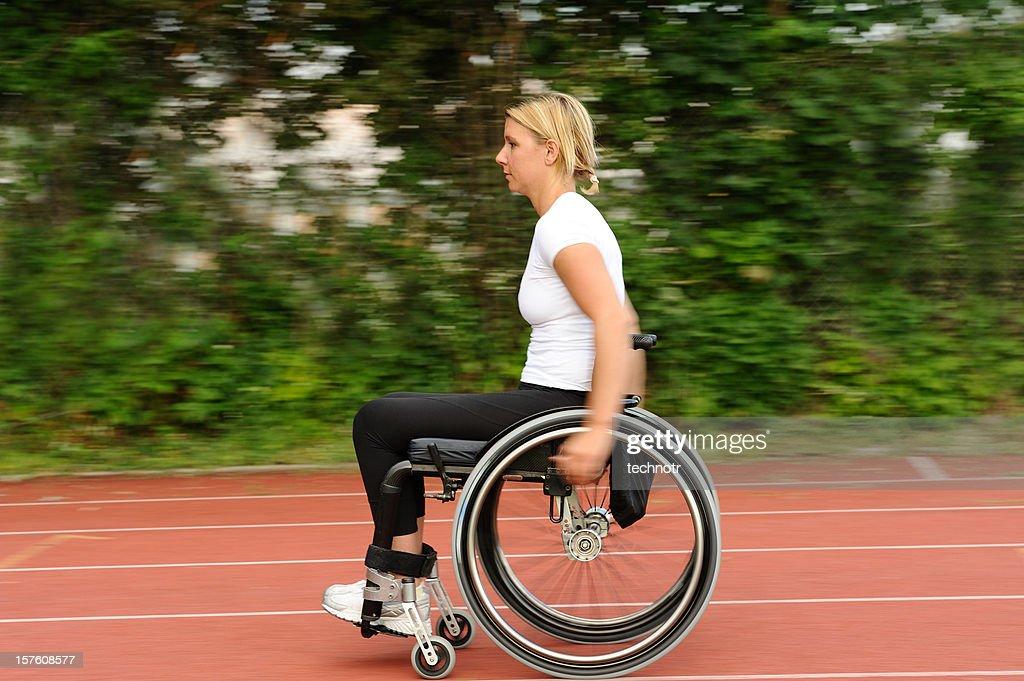 Paraplegic on wheelchair exercising : Stock Photo